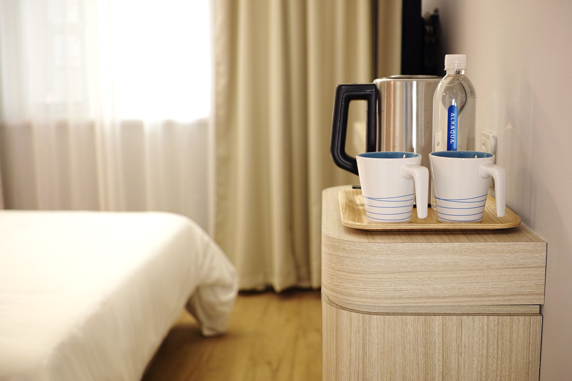 tea, coffee pot and water in a hotel room